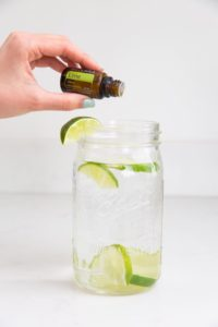 doTERRA Lime essential oil in a glass of water